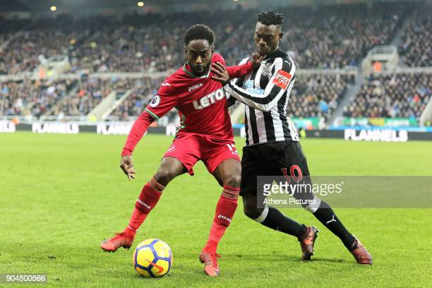 Nathan Dyer of Swansea City challenged by Christian Atsu of Newcastle during the Premier League match between Newcastle United and Swansea City at St...