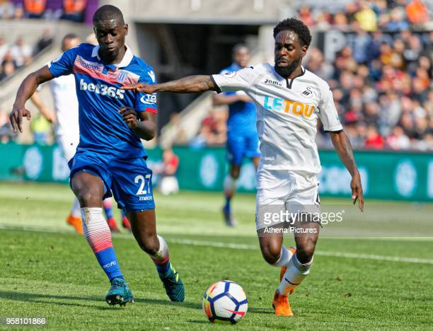 Nathan Dyer of Swansea City closely marked by Badou Ndiaye of Stoke City during the Premier League match between Swansea City and Stoke City at The...