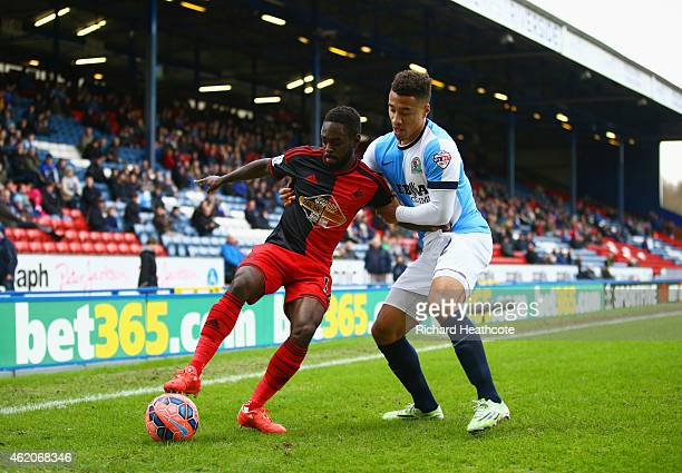 Nathan Dyer of Swansea City holds off Adam Henley of Blackburn Rovers during the FA Cup Fourth Round match between Blackburn Rovers and Swansea City...