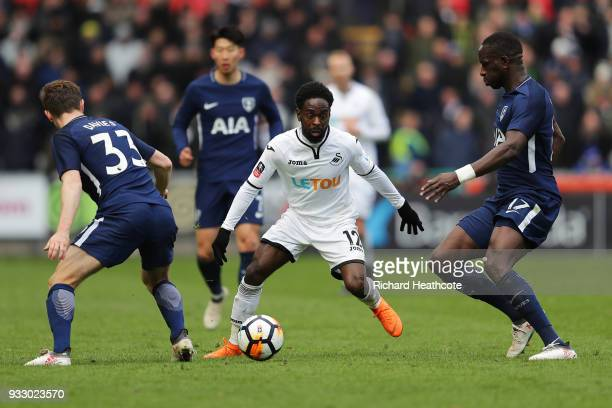 Nathan Dyer of Swansea City is challenged by Moussa Sissoko of Tottenham Hotspur during The Emirates FA Cup Quarter Final match between Swansea City...