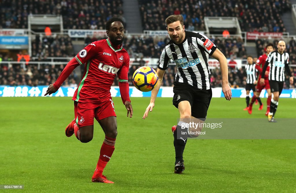 Nathan Dyer of Swansea City is challenged by Paul Dummett of Newcastle United during the Premier League match between Newcastle United and Swansea City at St. James Park on January 13, 2018 in Newcastle upon Tyne, England.