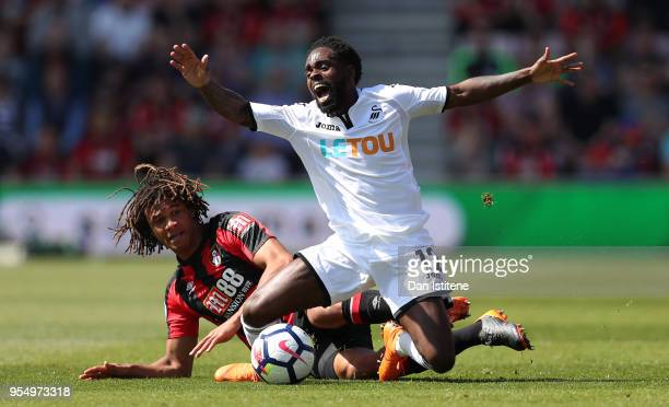 Nathan Dyer of Swansea City is challenged Nathan Ake of AFC Bournemouth during the Premier League match between AFC Bournemouth and Swansea City at...