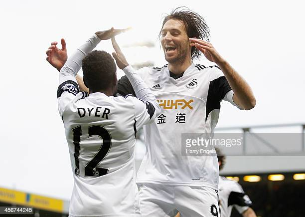 Nathan Dyer of Swansea City is congratulated by teammate Michu after scoring his side's first goal during the Premier League match between Norwich...