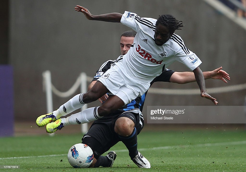Nathan Dyer of Swansea City is fouled by Andy Wilknson of Stoke City during the Barclays Premier League match between Swansea City and Stoke City at the Liberty Stadium on October 2, 2011 in Swansea, Wales.