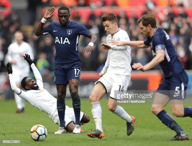 Nathan Dyer of Swansea City is fouled by Moussa Sissoko of Tottenham Hotspur during The Emirates FA Cup Quarter Final match between Swansea City and...
