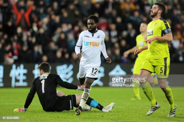 Nathan Dyer of Swansea City scores his first goal against Adam Collin of Notts County during The Emirates FA Cup match between Swansea City and Notts...