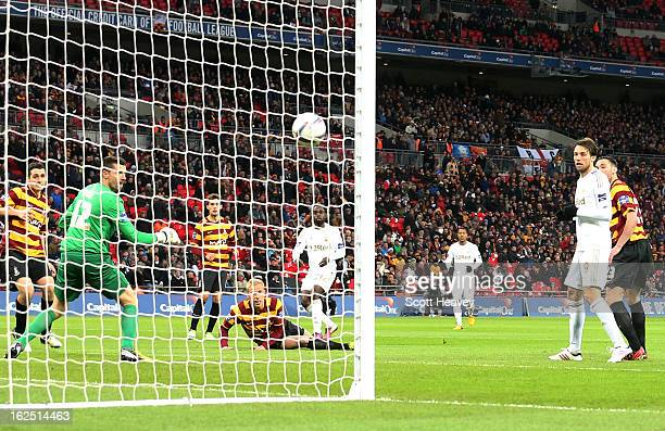 Nathan Dyer of Swansea City scores their third goal during the Capital One Cup Final match between Bradford City and Swansea City at Wembley Stadium...
