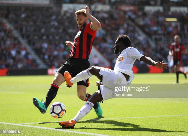 Nathan Dyer of Swansea City tackles Simon Francis of AFC Bournemouth during the Premier League match between AFC Bournemouth and Swansea City at...