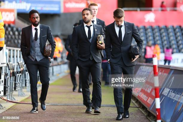 Nathan Dyer Wayne Routledge and Tom Carroll arrives at Liberty Stadium prior to kick off of the Premier League match between Swansea City and...