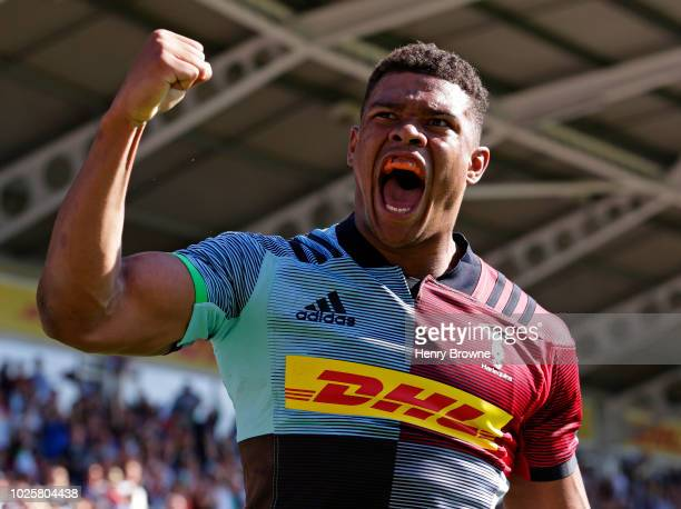 Nathan Earle of Harlequins celebrates after scoring their second try during the Gallagher Premiership Rugby match between Harlequins and Sale Sharks...