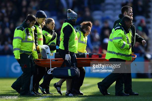 Nathan Earle of Harlequins goes off injured during the Gallagher Premiership Rugby match between Harlequins and Northampton Saints at Twickenham...