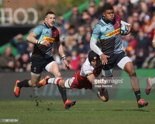 Nathan Earle of Harlequins is tackled by Piers Francis of Northampton Saints during the Gallagher Premiership Rugby match between Harlequins and...
