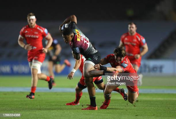 Nathan Earle of Harlequins is tackled by Tom Curry of Sale Sharks during the Gallagher Premiership Rugby match between Harlequins and Sale Sharks at...