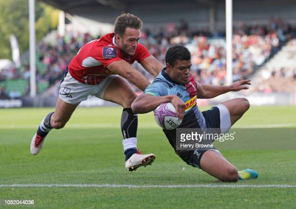 Nathan Earle of Harlequins touches down for his sides fourth try despite the efforts of Loris Tolot of Agen during the European Rugby Challenge Cup...