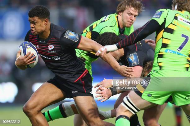 Nathan Earle of Saracens breaks through the Northampton Saints defence during the European Rugby Champions Cup match between Saracens and Northampton...