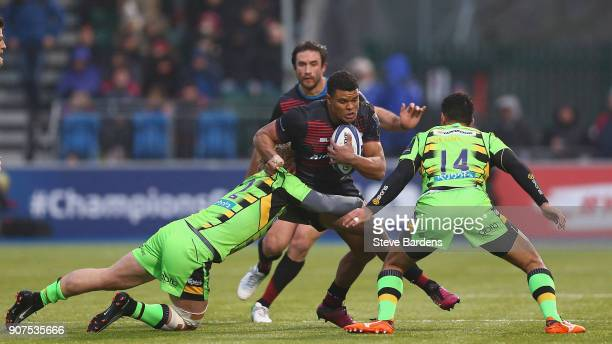Nathan Earle of Saracens is tackled by Tom Stephenson of Northampton Saints during the European Rugby Champions Cup match between Saracens and...