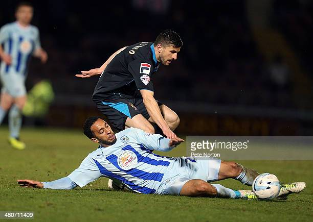 Nathan Eccleston of Coventry City attempts to control the ball under pressure from John Mousinho of Stevenage during the Sky Bet League One match...