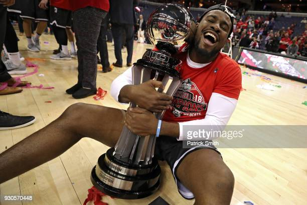 Nathan Ekwu of the Davidson Wildcats celebrates with the trophy after defeating the Rhode Island Rams in the Championship of the Atlantic 10...