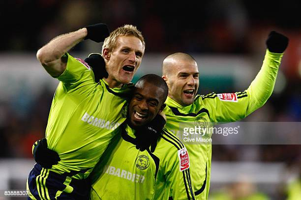 Nathan Ellington of Derby County celebrates with his team mates Emanuel Villa and Gary Teale on the final whistle during the Carling Cup quarter...