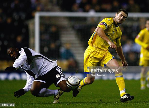 Nathan Ellington of Derby County is challenged by Frazer Richardson of Leeds United duing the Carling Cup Fourth Round match between Derby County and...