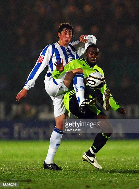 Nathan Ellington of Derby is challenged by Tommy Elphick of Brighton during the Carling Cup Third Round match between Brighton and Hove Albion and...