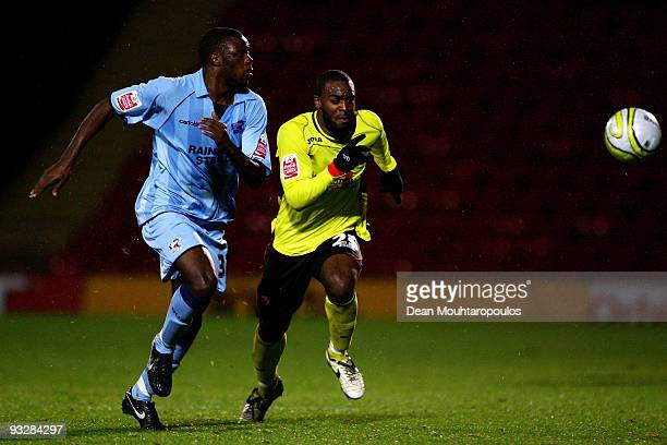 Nathan Ellington of Watford and Bondz N'Gala of Scunthorpe chase the loose ball during the Coca Cola Championship match between Watford and...