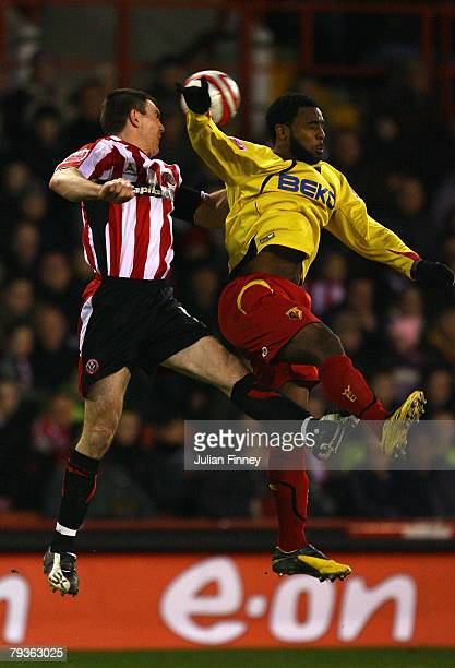 Nathan Ellington of Watford battles in the air with Chris Morgan of Sheffield United during the Coca-Cola Championship match between Sheffield United...