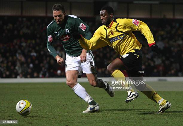 Nathan Ellington of Watford contests with Krisztian Timar of Plymouth during the Coca-Cola Championship match between Watford and Plymouth Argyle at...