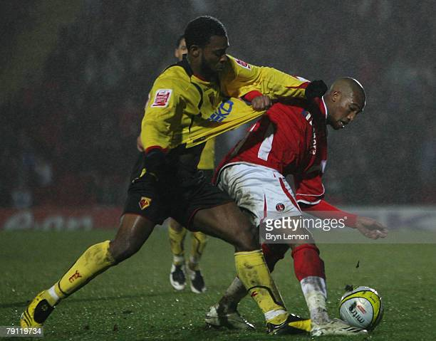 Nathan Ellington of Watford tackles Yassin Moutaouakil of Charlton Athletic uring the Coca-Cola Championship match between Watford and Charlton...
