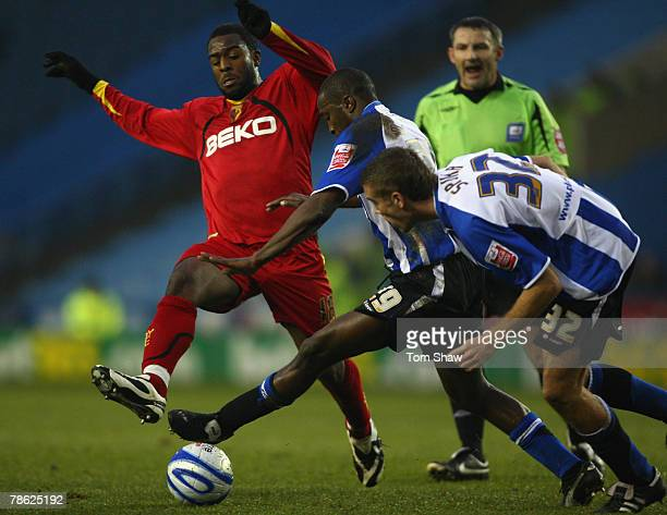 Nathan Ellington of Watford tussles with Michael Johnson and Tommy Spurr of Sheffield during the Coca Cola Championship match between Sheffield...