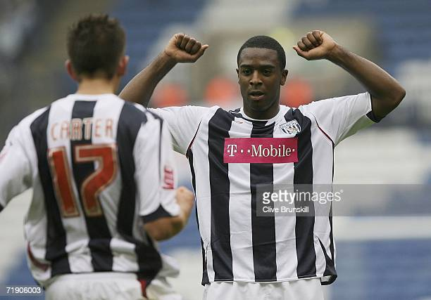 Nathan Ellington of West Brom celebrates scoring with Richard Chaplow during the CocaCola Championship match between West Bromwich Albion and...