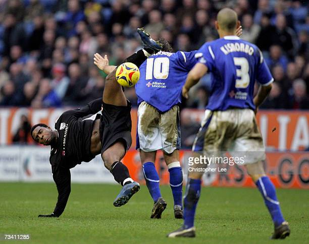 Nathan Ellington of West Brom falls to the ground after jumping to head the ball with Andy Johnson of Leicester City during the Coca-Cola...