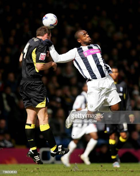 Nathan Ellington of West Brom goes up for a header with Martin Taylor of Birmingham during the Coca-Cola Championship match between West Bromwich...