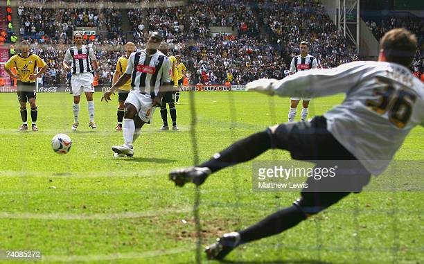 Nathan Ellington of West Bromwich Albion beats David Lucas of Barnsley to score from the penalty spot during the CocaCola Championship match between...