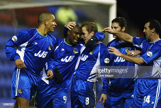 Nathan Ellington of Wigan Athletic celebrates his goal with his teammates during the Worthington Cup fourth round match between Wigan Athletic and...