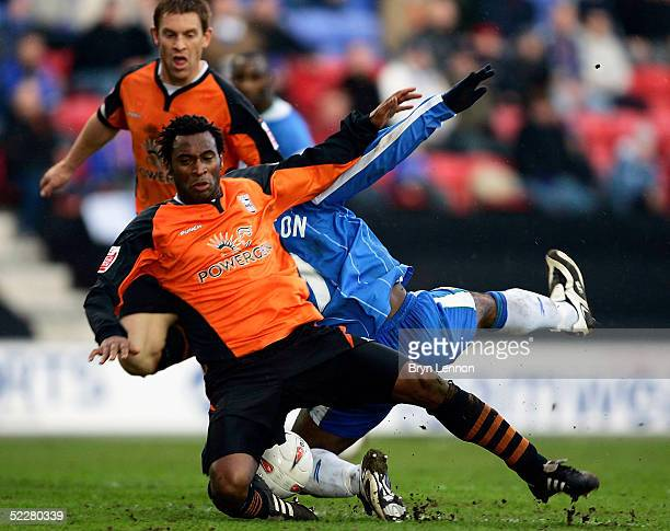 Nathan Ellington of Wigan Athletic is brought down by Fabian Wilnis of Ipswich Town during the CocaCola Football League Championship match between...