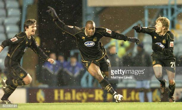Nathan Ellington of Wigan wheels away after scoring a goal during the CocaCola Championship match between Coventry City and Wigan Athletic at...