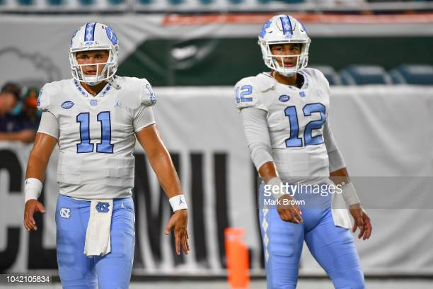 Nathan Elliott and Chazz Surratt of the North Carolina Tar Heels warm up before the game against the Miami Hurricanes at Hard Rock Stadium on...