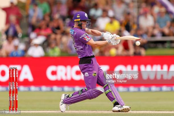 Nathan Ellis of the Hurricanes bats bats during the Big Bash League match between the Hobart Hurricanes and the Sydney Sixers at Traeger Park on...