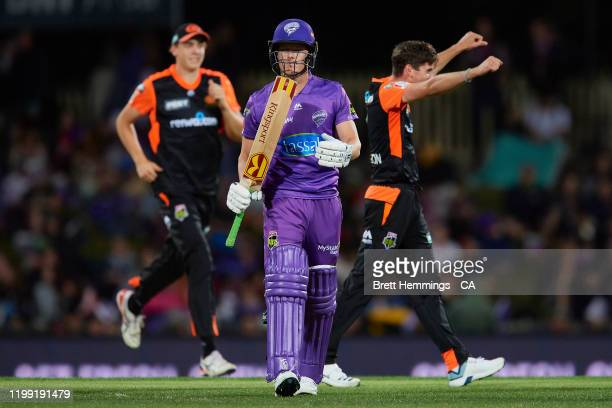 Nathan Ellis of the Hurricanes walks from the field after being dismissed by Jhye Richardson of the Scorchers during the Big Bash League match...