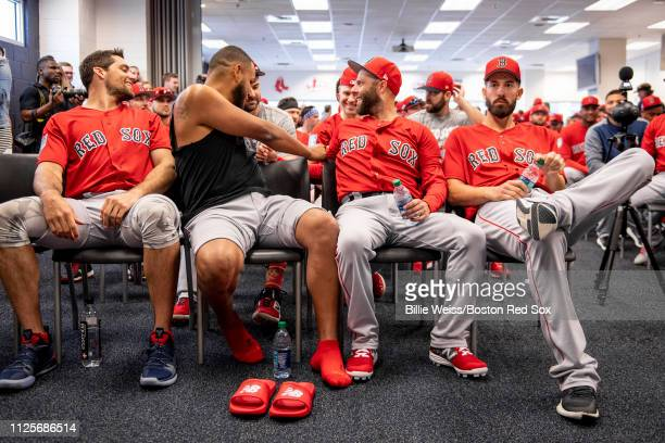 Nathan Eovaldi Eduardo Rodriguez Dustin Pedroia and Rick Porcello of the Boston Red Sox reacts during a team meeting before a team workout on...