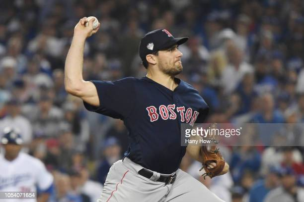 Nathan Eovaldi of the Boston Red Sox delivers the pitch during the twelfth inning against the Los Angeles Dodgers in Game Three of the 2018 World...