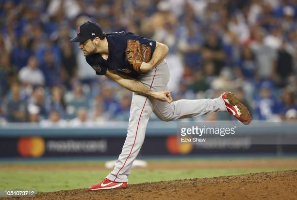 Nathan Eovaldi of the Boston Red Sox delivers the pitch during the thirteenth inning against the Los Angeles Dodgers in Game Three of the 2018 World...