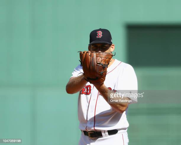 Nathan Eovaldi of the Boston Red Sox looks on before pitching at the top of the first inning of the game against the New York Yankees at Fenway Park...