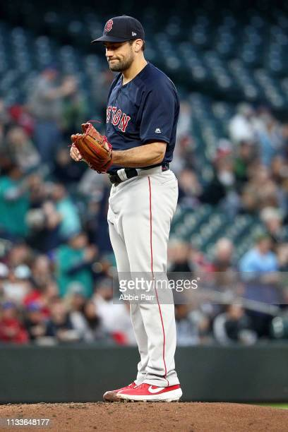 Nathan Eovaldi of the Boston Red Sox reacts after giving up a solo home run to Domingo Santana of the Seattle Mariners in the first inning during...