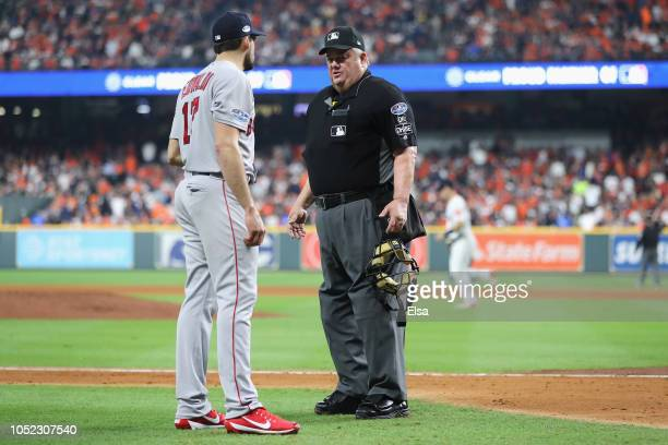 Nathan Eovaldi of the Boston Red Sox talks with umpire Joe West in the second inning during Game Three of the American League Championship Series...