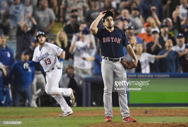 Nathan Eovaldi of the Boston Red Sox watches the ball leave the park as Max Muncy of the Los Angeles Dodgers hits and eighteenth inning walkoff home...