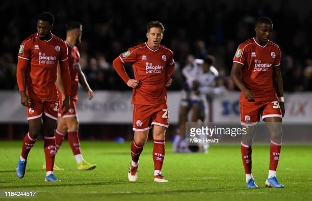 Nathan Ferguson, Dannie Bulman and Beryly Lubala of Crawley Town react to Colchester United scoring there third goal during the Carabao Cup Round of...