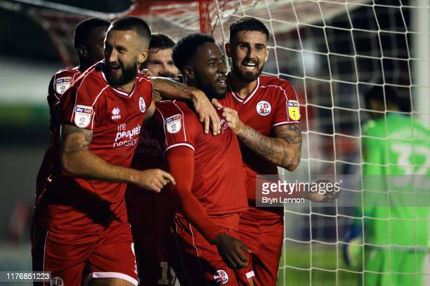 Nathan Ferguson of Crawley Town celebrates scoring with his team mates during the Carabao Cup Third Round match between Crawley Town and Stoke City...
