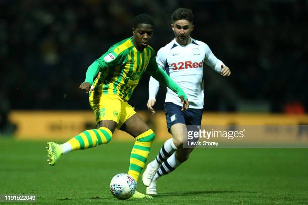Nathan Ferguson of West Bromwich Albion makes a pass whilst under pressure from Sean Maguire of Preston North End during the Sky Bet Championship...